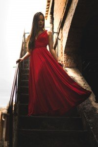 woman wearing red dress standing on staircase 1755428